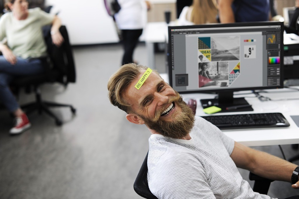 happy employee at desk